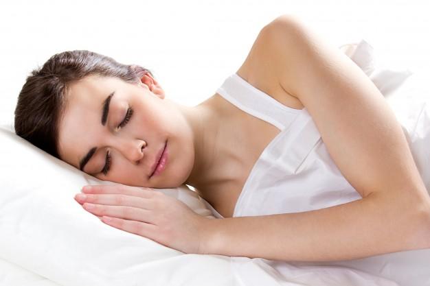 female-sleeping-bed_1301-2313
